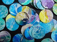 painting watercolor paper with watercolors, salt, and glue- This would be great for altered art but I think I see earrings and pendants with resin coating for protection