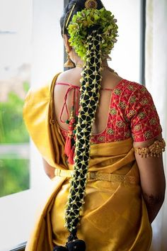 South Indian bride. Gold Indian bridal jewelry.Temple jewelry. Jhumkis.Yellow silk kanchipuram sari with contrast embroidered blouse.Braid with fresh flowers. Tamil bride. Telugu bride. Kannada bride. Hindu bride. Malayalee bride.Kerala bride.South Indian wedding.