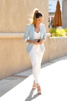 white denims and powder blue blazer.