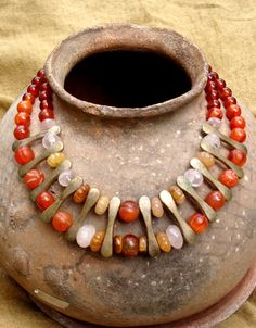 by Georgie of Nishiibo Designs.  A mixture of ancient 'pumpkin/melon' carnelian beads are combined with some new carnelian beads, tiger eye, yellow aventurine and rose quartz.  The divers are old Tibetan brass beads.  {SOLD}