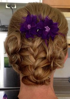 fancy braided updo with hair flowers