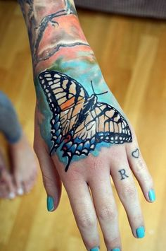 Artist: Radu Rusu  ::  Amazing and such a colorful tiger swallowtail butterfly hand tattoo