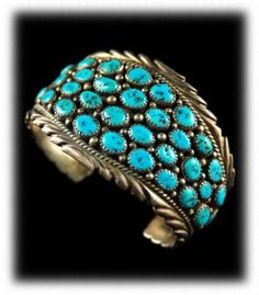 Vintage Women's Kingman Turquoise Bracelet         Vintage cluster style womens Kingman Turquoise bracelet by Navajo artist William Many Goats.