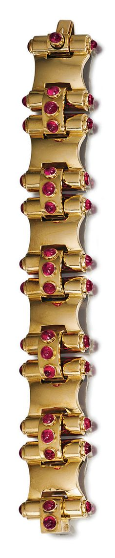 RUBY AND YELLOW GOLD BRACELET, CIRCA 1940.  The articulated band composed of six stylised scrolls decorated with cabochon ruby terminals, linked by bombé-shaped spacers set with three similar stones, mounted in yellow gold, length approximately 180mm, French assay marks.