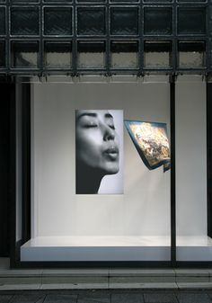 """Souffle"" window display of the Maison Hermès designed by Tokujin Yoshioka - the window is designed with an image of a woman projected on the monitor. The scarf softly sways in the air in response to the woman's blow"