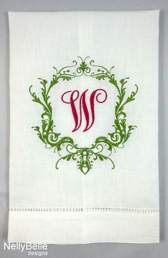 Monogrammed guest towel in Christmas colors. NellyBelle Designs