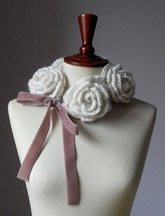 Crochet Rose Scarf -- I love this!!  Link is a tutorial for crochet roses. My guess is that they sew/link a few of these together and attach ribbon to these ends.  Gonna try this!