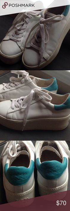 Ash Cult platform sneakers Ash Cult Womens Leather Trainers in White. Ash CULT trainer is back in smooth white leather with an eyecatching turquoise blue accent on the ankle cuff for SS15. With its chunky double sole and classic lace up fastening, style with loose tailoring for a fashion forward look. Same pair that was spot on Gigi Hadid. No damages to the shoes. Ash Shoes