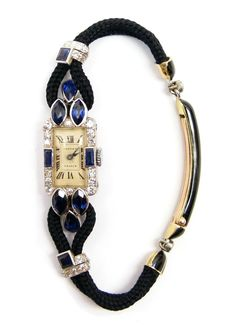 Art Deco sapphire and diamond lady's wristwatch by Cartier, Paris c.1925   , the cream rectangular dial with black Roman numerals, diamond set bezel with rectangular cut sapphires to either side, thre