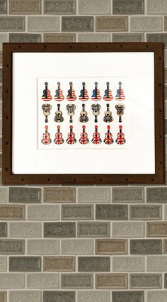 From our Anvil Collection, this outstanding artwork comprised of mini homemade wooden guitars was paired with a thick Rag matboard and an aged-metal looking frame, all designed to complement its craftsmanship and detail. 🎸 -------------- #custom #framing #frames #picture #guitar #art #painting Picture Frame Store, Wendy Davis, Guitar Art, All Design, Custom Framing, Guitars, Framed Art, Original Art, Frames