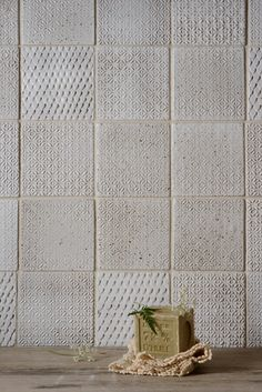 We love our handmade ceramic tiles on this splashback. It has been created using the Whitechapel and Dove House designs
