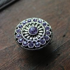 Crystal Drawer Knobs - Furniture Knobs with Violet Glass Crystals in Silver $8.25 If you are looking for a quick update to a piece of furniture in your home, these beautiful silver and crystal drawer knobs are just the thing! They can be used as cabinet knobs in a kitchen or bathroom, or add sparkle to a dresser! Furniture knobs are a quick way to add interest to any space, and the sophisticated elegance of these drawer pulls are the way to go!