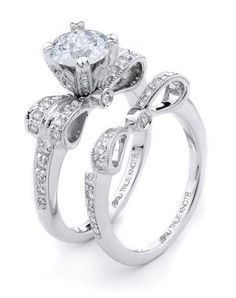 Sparkling with 0.45tcw of diamonds, this white gold engagement ring is sure to win her heart | True Knots | https://www.theknot.com/fashion/the-knot-collection-k3067-true-knots-wedding-ring