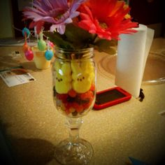 Our homemade Easter centerpieces! Jelly beans, peeps, and flowers in redneck wine glasses.