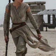 Rey Cosplay / Halloween costume (star wars) More pictures to follow.. Custom made Rey costume. Includes drape top, undershirt, belt, arm wraps and perhaps staff any Fanny pack. Make an offer Disney Other