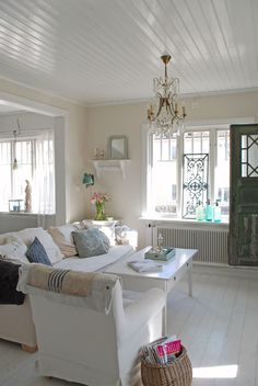 super pretty - especially the bead board ceiling...a good way to refurbish a worn ceiling