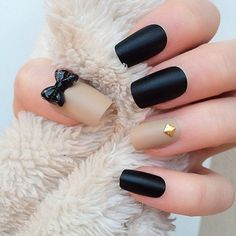 Glam nail art with a black bow
