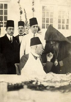 "Saad Zaghlul,[1858-1927], the nationalist Egyptian leader,minister,Speaker of the Assembly,Prime-Minister,and founder of the Wafd Party in 1919,who's motto was"" Religion belongs to God, and the Nation belongs to all "" .Zaghlul is seen holding the hand of the Armenian Patriarch of Alexandria,during a luncheon reception. 1920s"