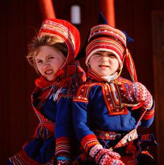 Sami boy and girl in traditional clothing. Kautokeino. Norway.© Bryan & Cherry Alexander Photography