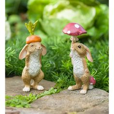LIFE NEEDS MORE BUNNIES! Who can resist our set of Veggie Rabbit Garden Figures? These sweet bunnies add joy wherever you display them: garden, flower pot or even in your kitchen. One dons a carrot top hat, while the other holds a mushroom parasol. Fairy Statues, Garden Statues, Garden Sculpture, Outdoor Statues, Rabbit Garden, Fairy Village, Fertilizer For Plants, Miniature Fairy Gardens, Garden Beds