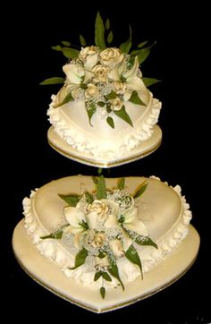 elegant white roses atop heart shaped   double layer wedding cake.
