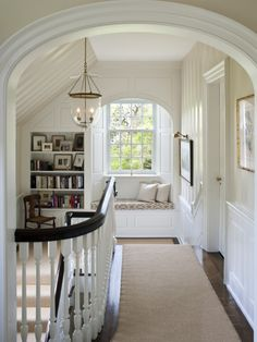 """arched doorway. window seat (made for crib mattress size - 28"""" x 52"""" and in each kid's room). built-in bookshelf for hallway upstairs, make stair pickets straight/square with dark railing"""