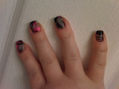 Marble Nail Design!  Painted base of nails white, and dropped black and neon pink nail polish into a disposable cup full of water.  Swirled with a toothpick, and then dip nails into swirl!  Makes a big mess around your nails, but once its dry,easy to clean up with nail polish remover and q tips (lots of them!)  I recommend putting Vaseline AROUND your nails (NOT on them or polish won't stick) first...so the nail polish scrapes off easy after!