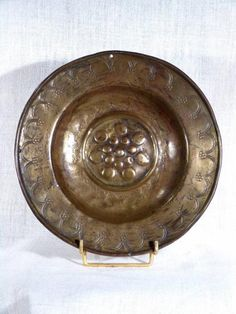 Antique Middle Ages gothic offerings plate with circles and flowers