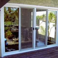 Sliding wood glass patio doors large outdoor designing for Triple french doors exterior