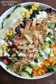 Shredded Chicken Taco Salad with Chipotle Ranch Crema Shredded chicken taco salad with chipotle ranch crema is shredded chicken layered on a delicious taco salad packed with fresh veggies and drizzled with a Chipotle Ranch Crema. Mexican Food Recipes, Dinner Recipes, Mexican Meals, Party Recipes, Mexican Dishes, Shredded Chicken Tacos, Taco Salads, Cooking Recipes, Healthy Recipes