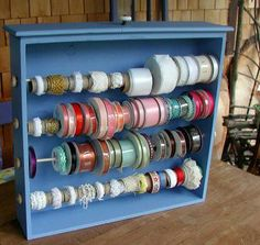 What a neat idea...a drawer turned into ribbon storage for the wall, etc.
