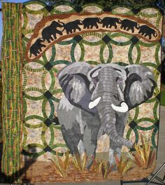 "Ancient Memories Wedding Quilt, 62 x 67"", by Lynn Drennen.  Original design. Double wedding rings for the longevity of marriage; elephants, known for their memories;  and a dragonfly for strength make up my wedding quilt."