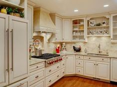 Following a complete change of scene from outdated oak cabinets, tile countertops and plain white appliances, this English Country-inspired kitchen provides all the style and function the client had hoped for.