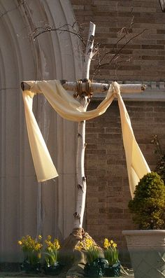Planning to take two limbs from a tree in our backyard and made a similar cross like this for our front porch.