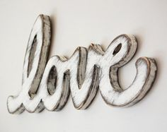 """love"" wooden letters sign"