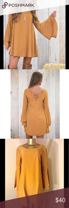 "HOST PICK BELL SLEEVE DRESS   TOP TREND LACE UP BELL SLEEVE DRESS length 32"" bust 38"" waist  40"" sleeve  loose fitting  Dresses Mini"