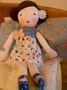 doll in pinafore