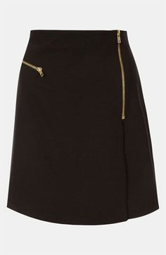 Black faux wrap skirt with exposed zippers can be styled in myriad ways.. DIY the look yourself: http://mjtrends.com/pins.php?name=brass-zipper-for-skirt_4