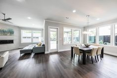 974 42nd St Houston, TX 77018: Photo  Huge windows ring the entire living space downstairs to let in tons of light.