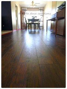 Little Dove Creations: i think i love you wood laminate flooring. Traffic Master Handscraped Saratoga Hickory.
