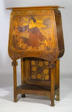 Gaspar Homar i Mesquida (1870-1953) - Secretary Desk with Marquetry Panel of a Woman. Carved Oak with Hardwood & Fruitwood Marquetry Inlaid Panels. Barcelona, Spain. Circa 1908. 179cm x 99.5cm x 45.5cm.