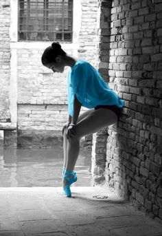 Beautiful dancer on a gray day in blue