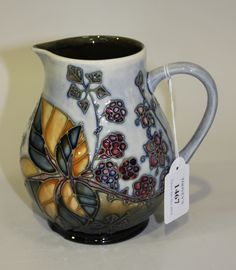 A Moorcroft pottery Bramble pattern jug by Sally Tuffin, circa 1997