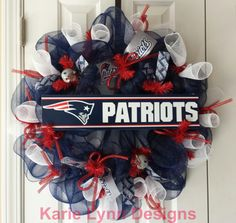 New England Patriots Wreath. So I am a Saints fan but the hubby loves the Pats. This would be a nice anniversary gift. Would match his flag on the porch !!
