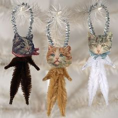 Oh my god....suicidal hanging cats. Nothing says christmas like cats hanging by glittery nooses.