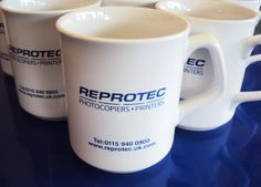 Promotional items for Reprotec.  White mugs, 1 colour print on both sides by Minuteman Press (Printers in Nottingham)
