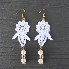 Tutorial shows you how to create these romantic lace earrings.