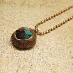 Beautiful necklace made of raw Turquoise stone and turquoise polymer clay decorated with copper metallic powder. DANA BROSH special design, oriental