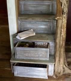 Brown devised the ingenious barn-wood stairs, which store linens, candles, and games.   - CountryLiving.com