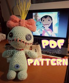 """PDF INSTRUCTIONS ONLY for Amigurumi Scrump, inspired by Lilos little Voodoo doll from Lilo and Stitch  ~Dimensions~ The finished amigurumi is about 24cm (9.5"""") without the bow and hair (which are about 14cm/5.5"""") tall. The size though may differ, depending on the yarn and hook size you use.  ~Difficulty~ Beginner - Intermediate  ~Materials~ • Crochet hook 3.5mm & 4mm • Yarn in Mint Green, Pink, Yellow (for the hair) and a piece of Black (for the mouth) • Stuffing • Three buttons, one..."""
